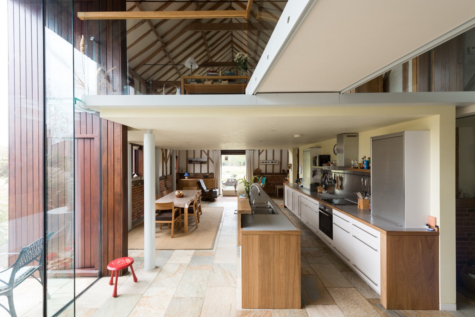 Kitchen, White, Laminate, Slate, Ceiling, Drop In, and Recessed The full height glazing amplifies the airy sense of interior space.  Best Kitchen Drop In Slate Photos from This Spectacular Suffolk Barn Conversion Hits the Market at $1.26M