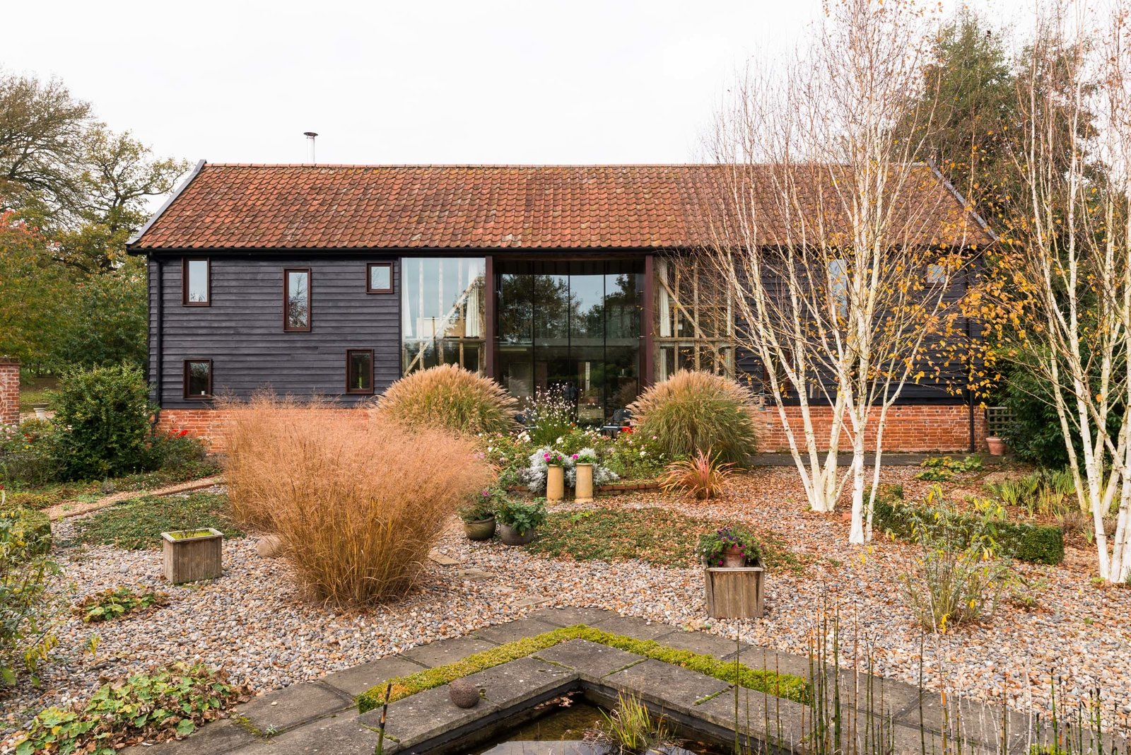 Exterior, Farmhouse, Brick, Wood, Gable, and Tile Additional glazing was added to the structure to increase the natural light.  Best Exterior Wood Gable Brick Photos from This Spectacular Suffolk Barn Conversion Hits the Market at $1.26M