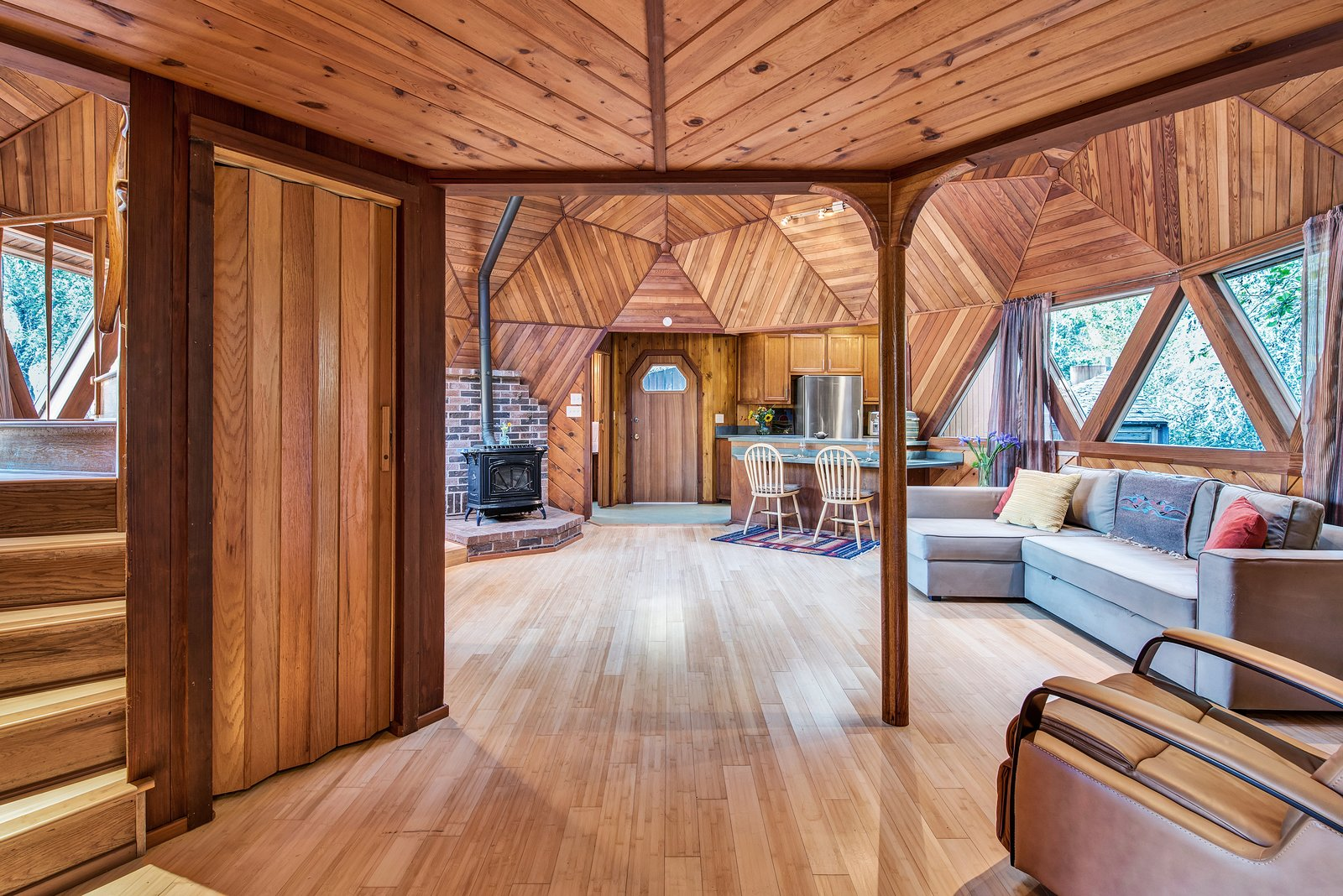 Living, Light Hardwood, Chair, Sectional, Track, and Recliner The open space is bright an airy, but has the feel of a private retreat in the forest.  Best Living Track Sectional Photos from A Geodesic Getaway in Northern California Asks $475K