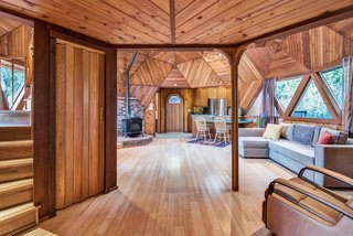 The open space is bright an airy, but has the feel of a private retreat in the forest.