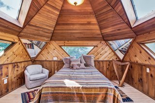 Watch the stars through triangular windows in the domed bedroom.
