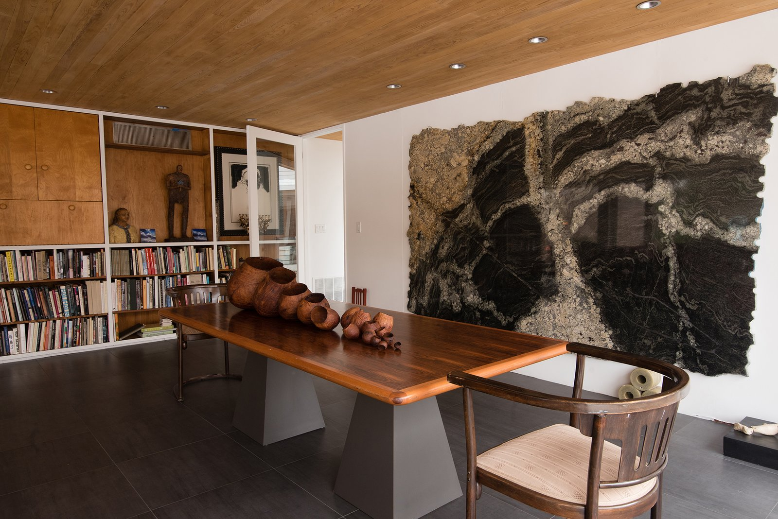 Dining, Table, Slate, Chair, Recessed, and Shelves The classic midcentury design becomes a natural setting for the owner's extensive art collection.  Best Dining Shelves Table Slate Photos from Snag This Midcentury Gem by Marcel Breuer That's Listed For $999K