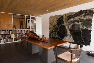 The classic midcentury design becomes a natural setting for the owner's extensive art collection.