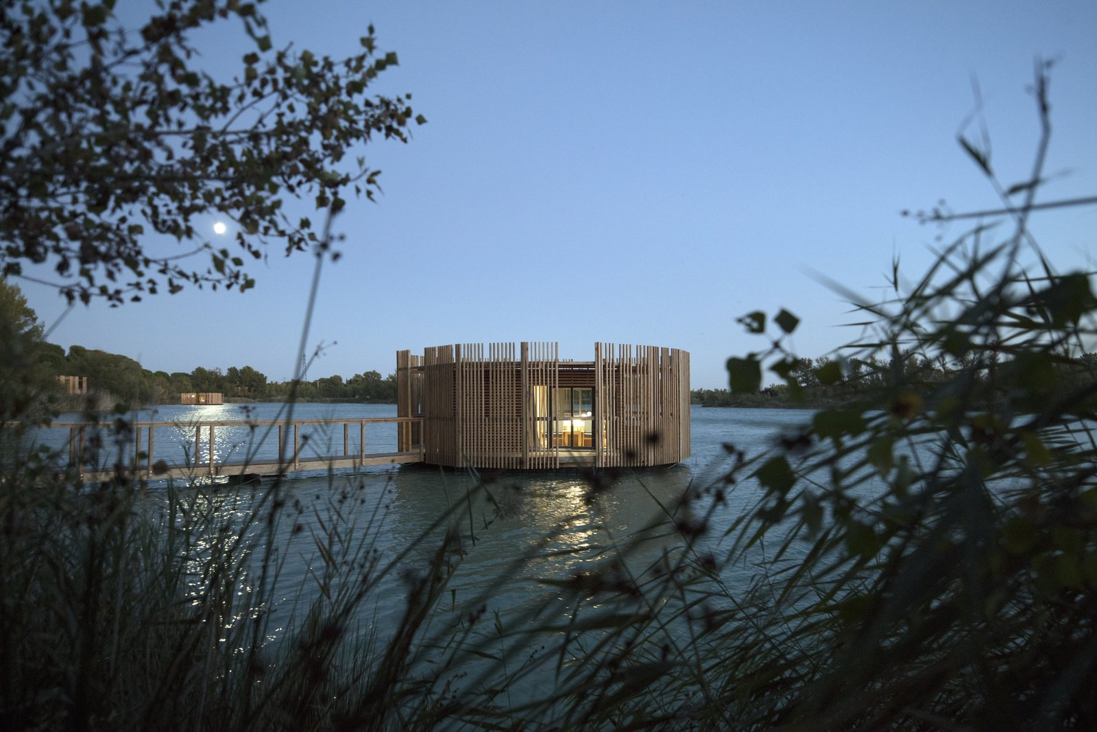 Exterior, Wood Siding Material, Prefab Building Type, Flat RoofLine, and Cabin Building Type Night views.  Photo 10 of 13 in Drift Off in a Prefab Cabin at This Floating Hotel in France