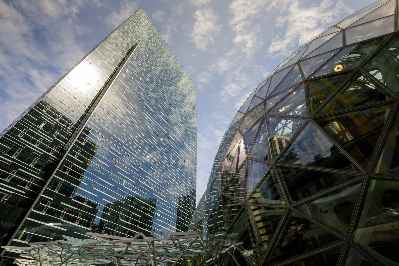 Exterior, Glass Siding Material, and Dome RoofLine The Spheres form a dramatic addition to the Amazon headquarters and a landmark in downtown Seattle, demonstrating the company's long-standing commitment to the city of which it is a part.  Photo 5 of 9 in Meet Downtown Seattle's Newest Landmark: The Amazon Spheres
