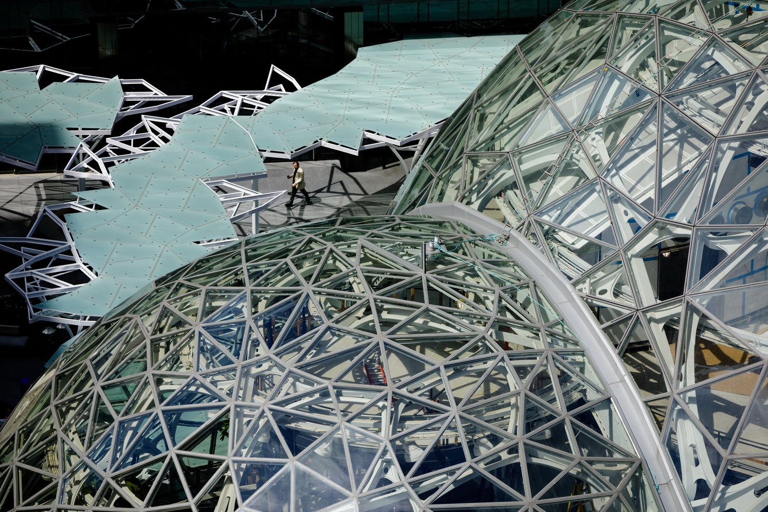Exterior, Dome RoofLine, and Glass Siding Material Design computation helped to generate the spheres, each a pentagonal hexecontahedron formed by tessellating a pentagon across its surface. Algorithms enabled the team to quickly generate a steel-and-glass structure that could be constructed efficiently and cost-effectively.  Photo 6 of 9 in Meet Downtown Seattle's Newest Landmark: The Amazon Spheres