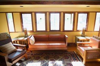 Art glass windows preside over the living room.
