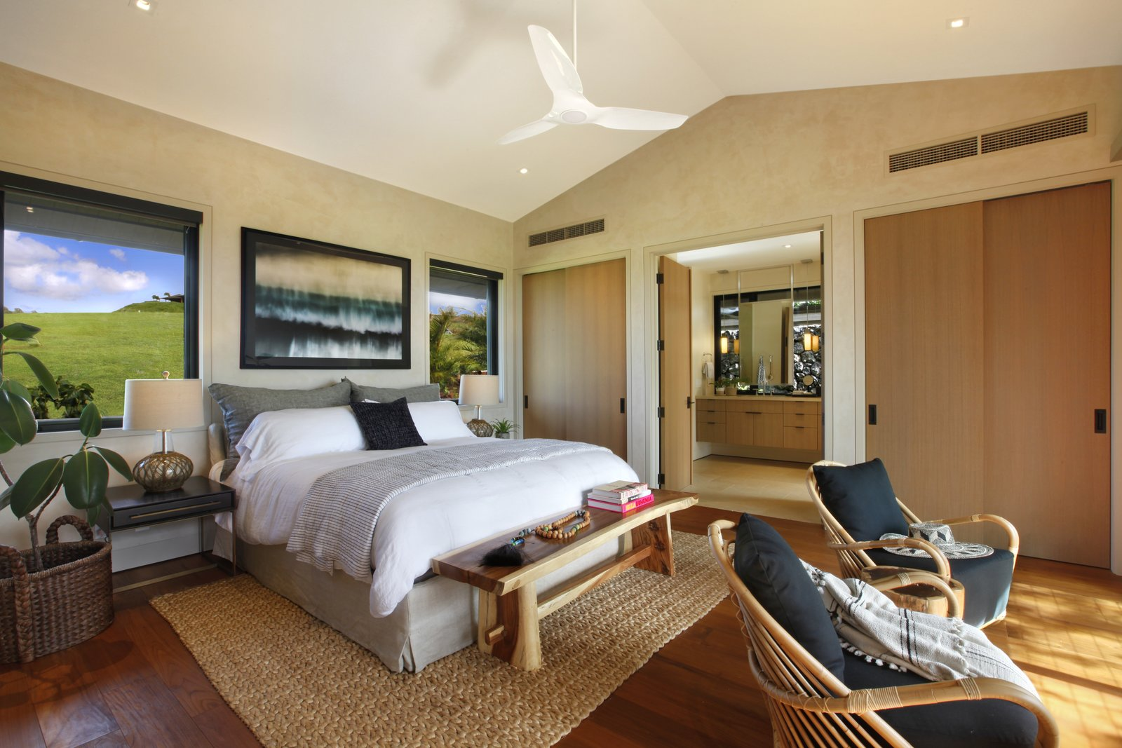 Bedroom, Bed, Bench, Medium Hardwood Floor, Ceiling Lighting, Chair, and Night Stands The bedroom features  Photo 5 of 14 in A Breezy Hawaiian Residence by Olson Kundig Hits the Market at $6.95M