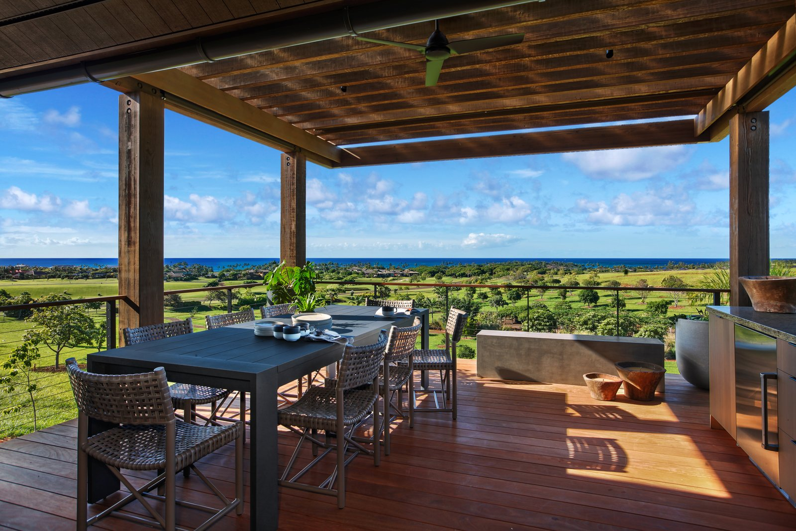 Outdoor, Back Yard, and Large Patio, Porch, Deck A covered exterior dining area around the pool.  Photo 9 of 14 in A Breezy Hawaiian Residence by Olson Kundig Hits the Market at $6.95M