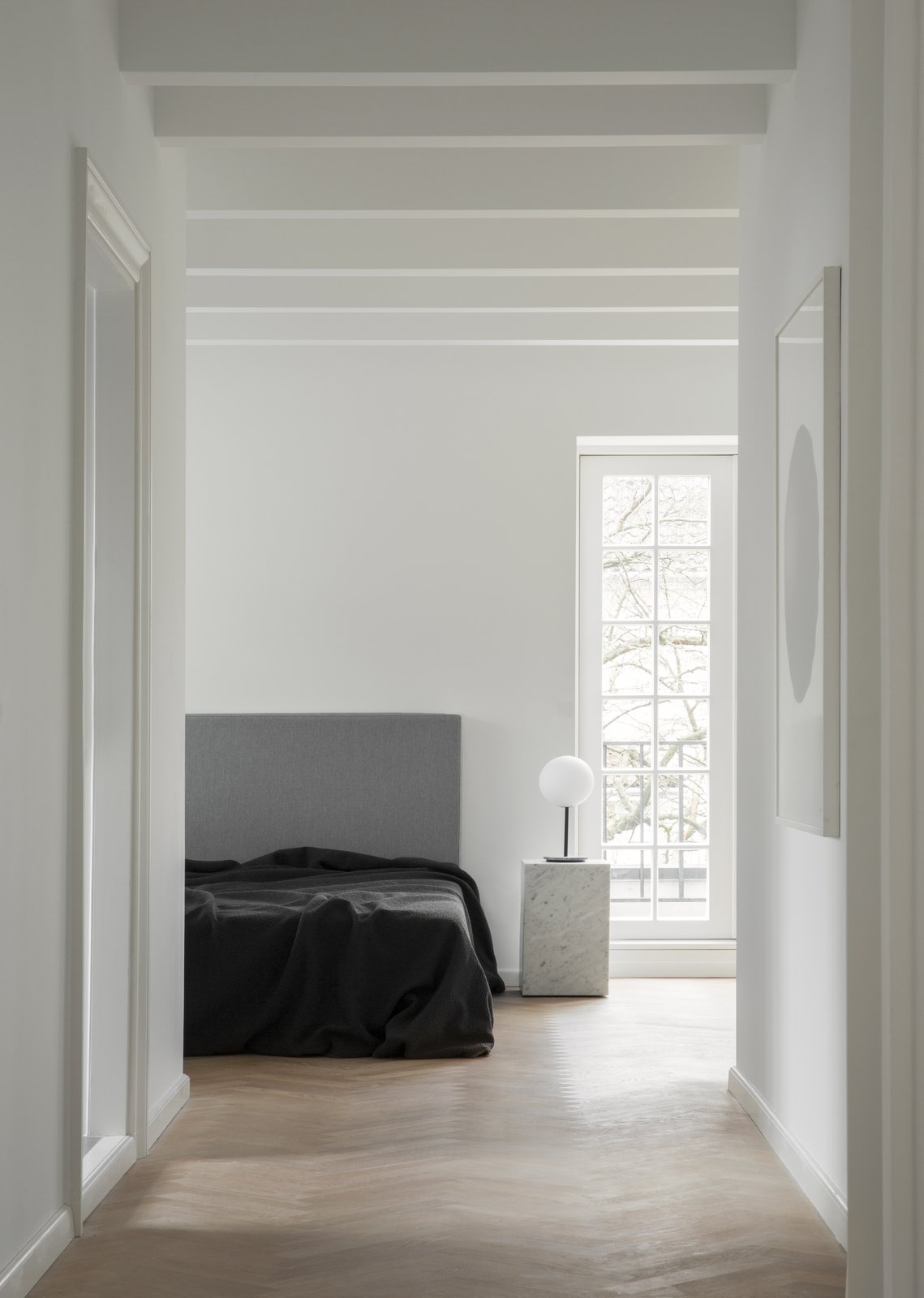 Bedroom, Night Stands, Table Lighting, Light Hardwood Floor, and Bed Every room of the house is light, bright, and comfortable to be in.  Photos from The Historic Villa Once Home to Poul Henningsen Receives a Modern Renovation