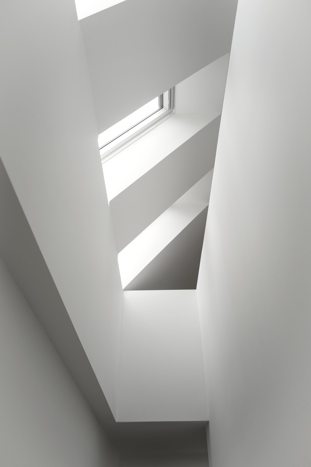 Windows and Skylight Window Type Skylights flooding the staircase in natural daylight and increasing the sense of height in the house.  Photo 9 of 13 in The Historic Villa Once Home to Poul Henningsen Receives a Modern Renovation