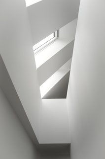 Skylights flooding the staircase in natural daylight and increasing the sense of height in the house.