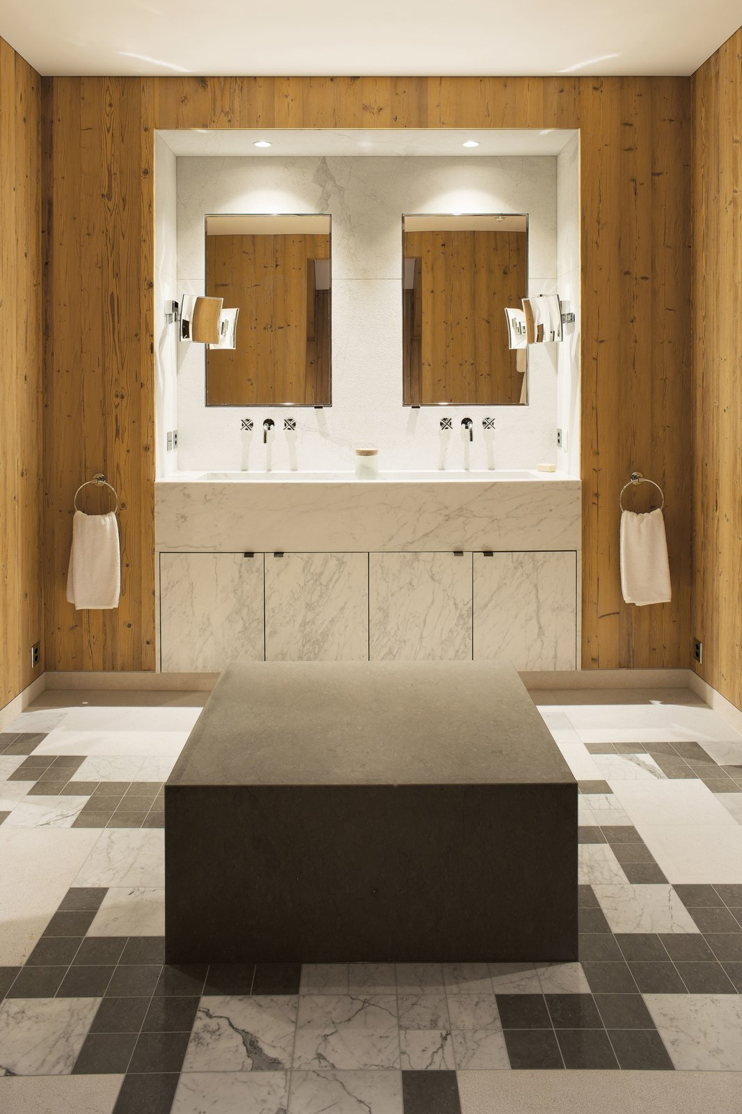 """Bath Room, Drop In Sink, Marble Floor, and Marble Counter The master bathroom's features a custom-made bench and marble mosaic flooring.  Search """"bathfloors--marble"""" from A Gorgeous Chalet in the Swiss Alps Perfectly Blends Modern and Rustic Design"""