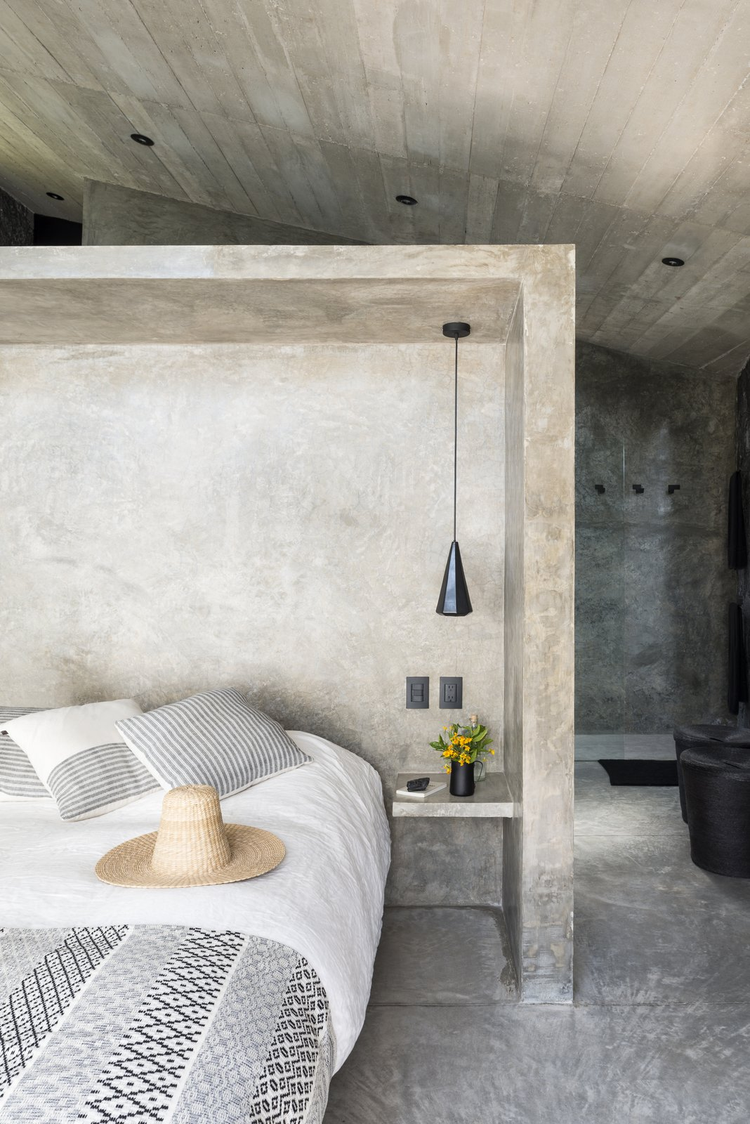 Bedroom, Cement Tile, Bed, Night Stands, Recessed, Concrete, and Pendant Beautiful minimal interiors are featured throughout.  Best Bedroom Pendant Cement Tile Photos from A Commanding Mexican Home of Stone and Concrete Is For Sale