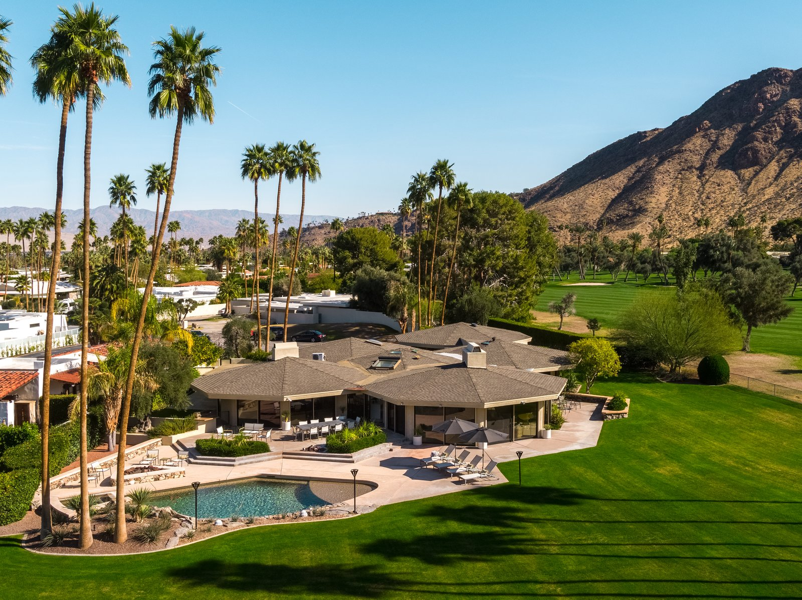 Outdoor, Grass, Trees, Desert, Back Yard, Swimming, and Large An aerial view of  Best Outdoor Desert Swimming Photos from Own William Krisel's Palm Springs Pod House For $2.5M