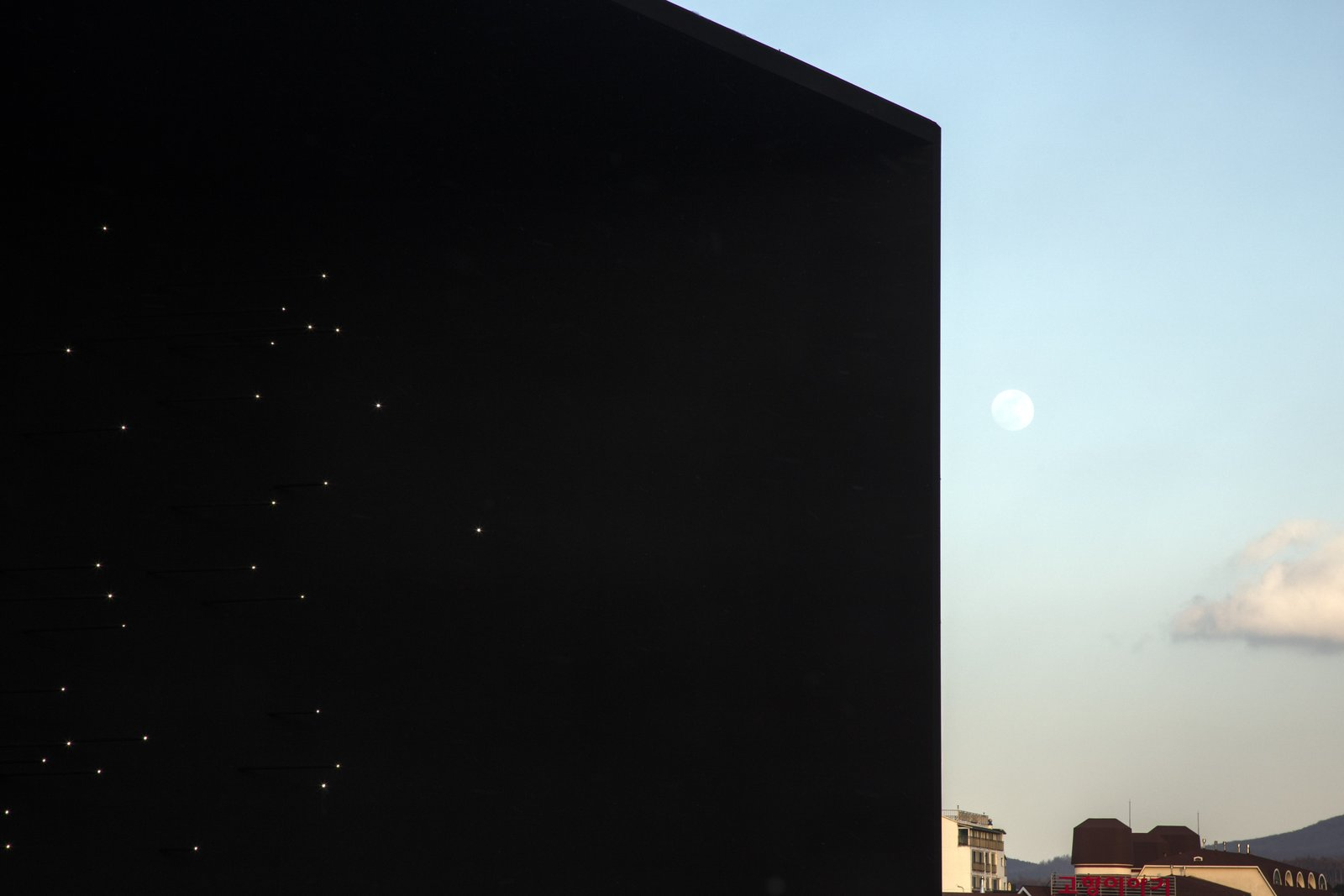The black façade represents the Universe – the origin of Hydrogen.  Photo 2 of 11 in The PyeongChang Winter Olympics in South Korea Debuts the Darkest Building on Earth