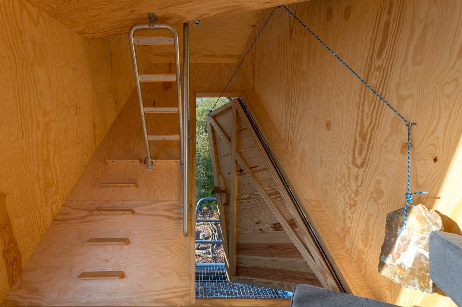 Doors, Swing Door Type, Exterior, and Wood The cabins come equipped with minimalist interiors and pulley-operated doors.   Photo 7 of 12 in Go Off The Grid With These Remote Rental Cabins in Cornwall