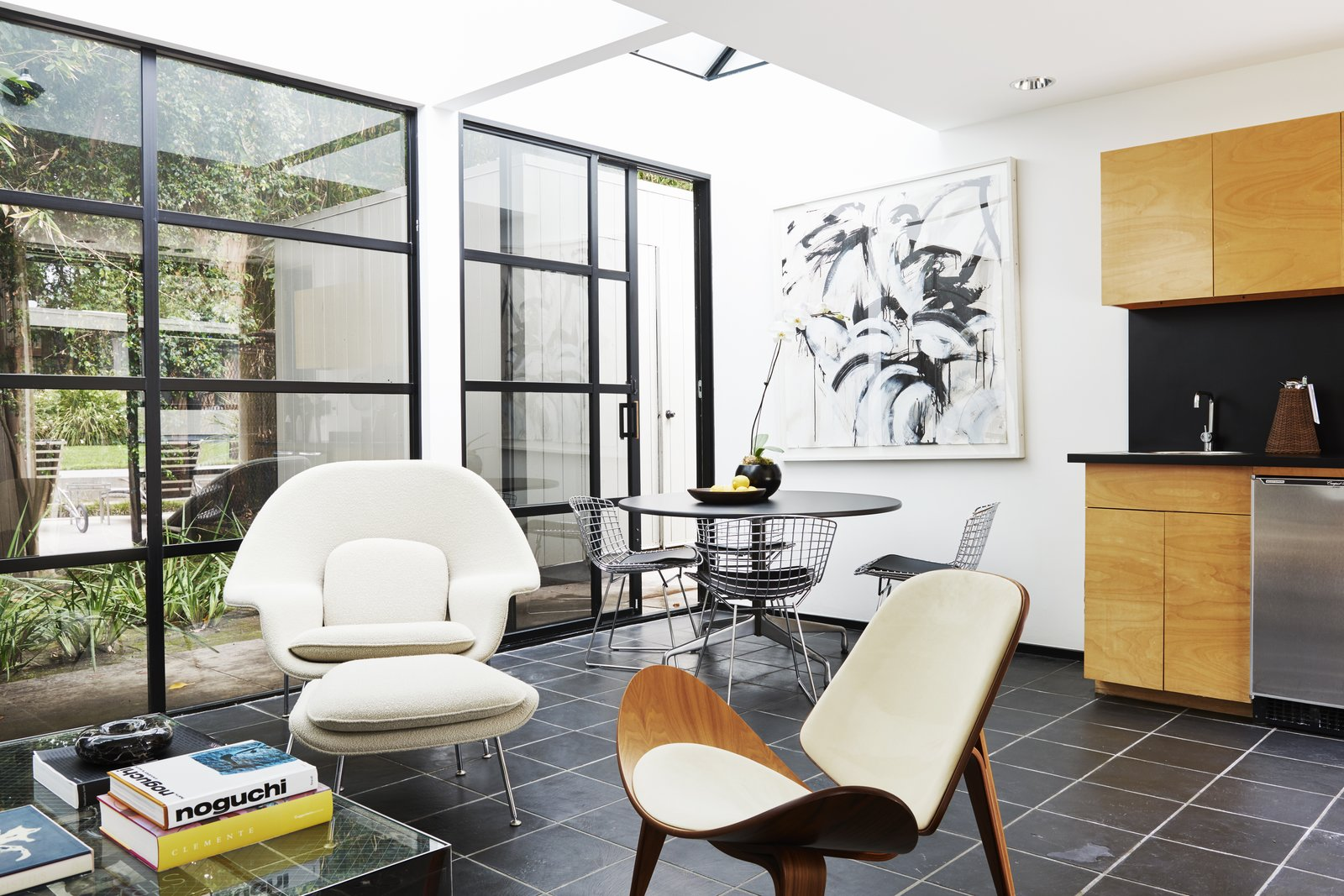 Living Room, Chair, Table, Shelves, Ceiling Lighting, and Slate Floor The home is perfect for entertaining.  Photo 6 of 15 in Jerry Bruckheimer Asks $11.9M For This Gem Designed by Thornton Abell