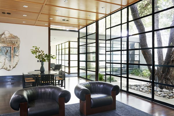 The high-ceilinged living area overlooks the courtyard.