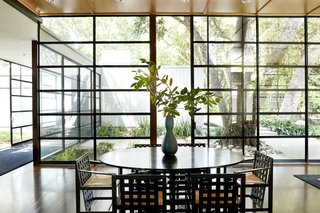 The glass wall of windows lets in plenty of natural light.