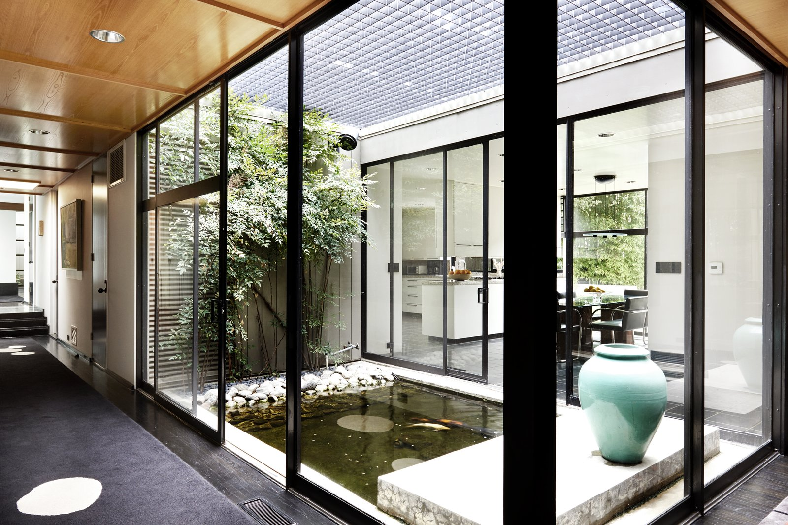 Hallway and Carpet Floor Interior courtyard with a pond.  Photo 9 of 15 in Jerry Bruckheimer Asks $11.9M For This Gem Designed by Thornton Abell