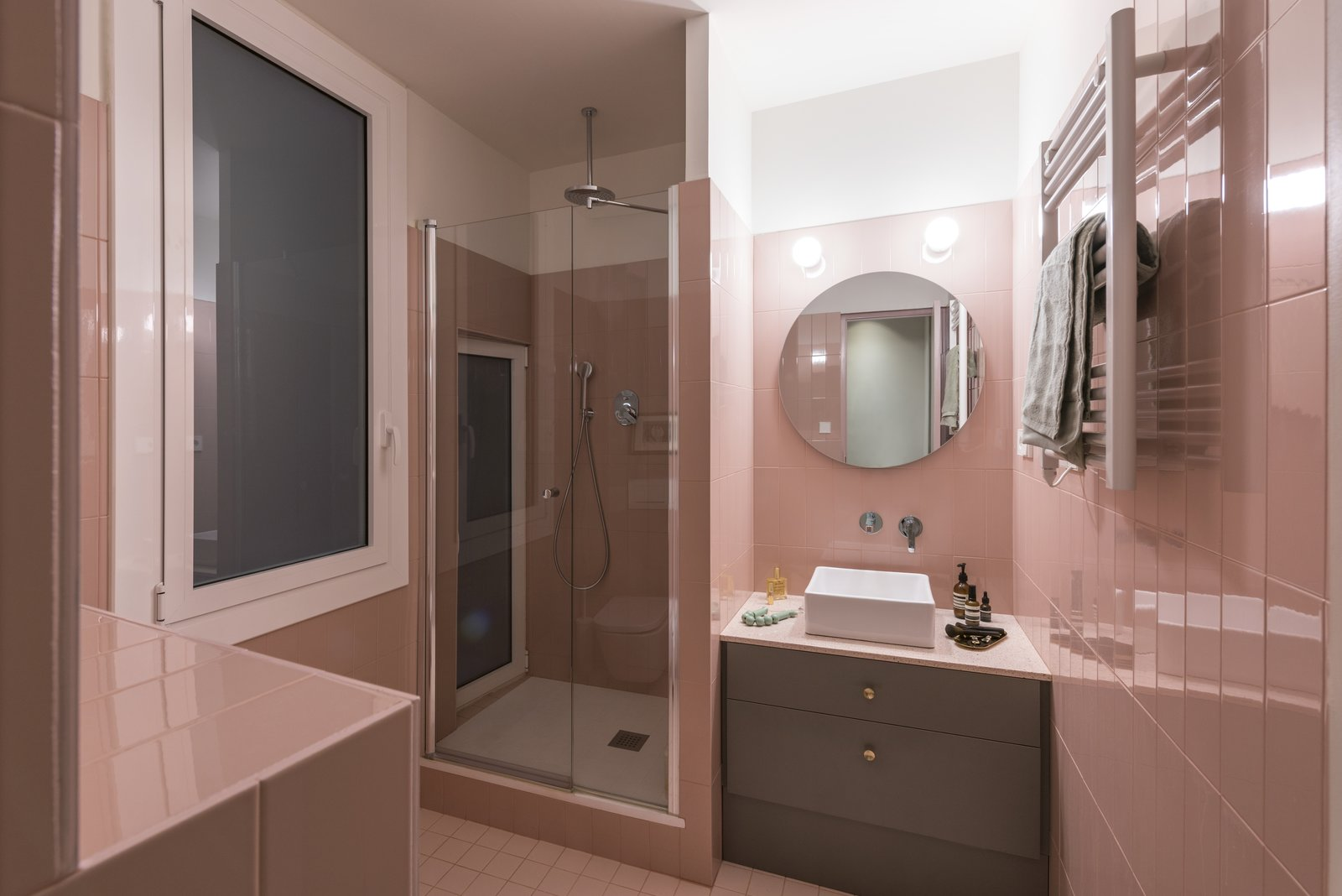 Bath, Wall, Porcelain Tile, Enclosed, Porcelain Tile, Vessel, Tile, and Corner The guest bathroom picks up on the pink lacquered them that runs throughout the apartment.  Best Bath Enclosed Wall Tile Photos from Before & After: An Ancient Barcelona Apartment Gets a Colorful, Chic Makeover