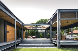 The terrace attaches to the main structure via a covered walkway.
