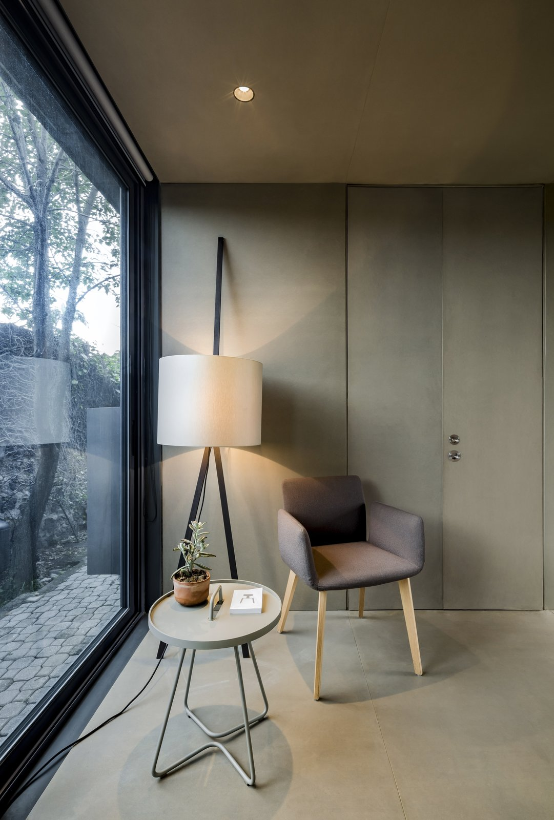 Bedroom, Floor, Storage, Slate, Recessed, and Chair Floor-to-ceiling windows ensure natural lighting to help keep the interiors bright.  Best Bedroom Chair Slate Photos from This Modern Prefab Is Now a Gorgeous Guest House