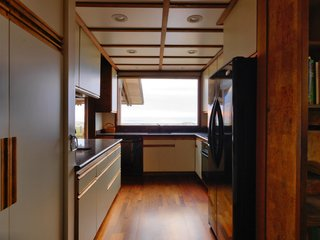 The kitchen has ample storage space and a sleek design.