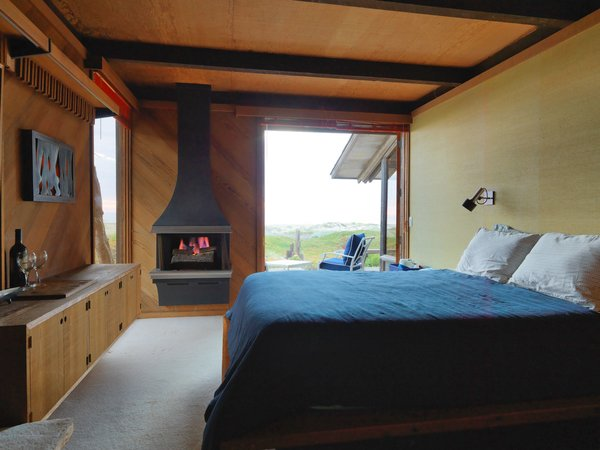 The master bedroom has a fireplace perfect for cool evenings.