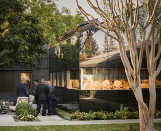 The pitched, low-slung roofs of the kitchen and annex allude to their utilitarian function.