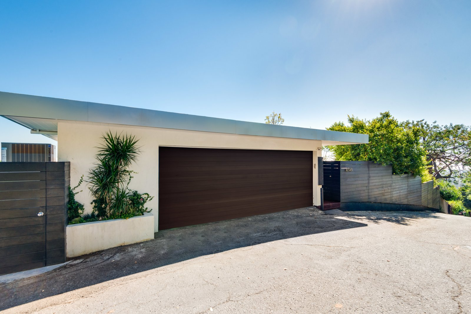 Exterior, Flat, Wood, Concrete, Mid-Century, Metal, and House The facade  Exterior Wood Metal Concrete Mid-Century Photos from A Renovated Harry Gesner–Designed Midcentury in L.A. Wants $9.4M