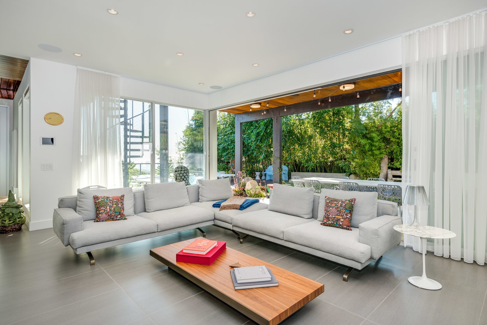 Living, Slate, Coffee Tables, Table, Sectional, End Tables, and Recessed The den opens up to the pool area.  Living Table Sectional Recessed Slate Photos from A Renovated Harry Gesner–Designed Midcentury in L.A. Wants $9.4M