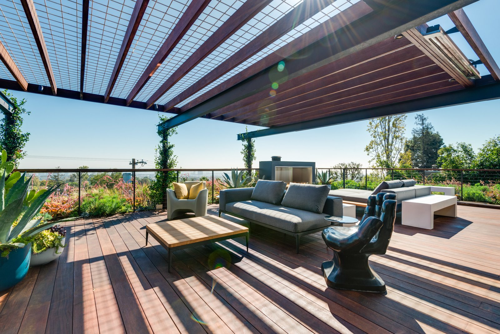 Outdoor, Wood, Metal, Decking, Rooftop, Planters, Horizontal, and Raised Planters The cantilevered flating Managris wood deck.  Best Outdoor Metal Photos from A Renovated Harry Gesner–Designed Midcentury in L.A. Wants $9.4M
