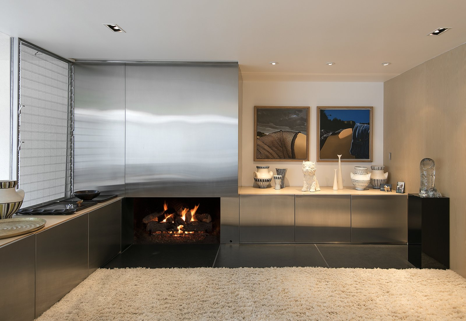 Living, Corner, Rug, Bar, Recessed, and Slate The living room includes a fireplace and hidden wet bar.  Living Bar Slate Photos from A Restored Midcentury Jewel by Richard Neutra Hits the Market at $13.5M