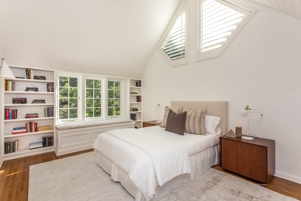 An additional bedroom with built-in bookshelves.