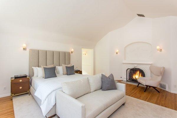 The wood-burning fireplace.
