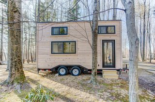 The Mohican tiny home has a starting price of $62,000, and it's made by Amish craftsmen in Ohio. The 20' tiny home, which can be built in as little as eight weeks, has an unfinished exterior and a light and bright, minimalist interior that packs all the essentials into a compact footprint.