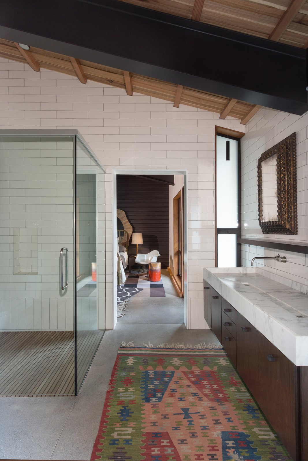 Bath, Enclosed, Slate, Drop In, Marble, Subway Tile, and Rug An ensuite bathroom is shared by two of the bedrooms.  Bath Enclosed Drop In Marble Rug Photos from A Private California Compound Hits the Market at $5M