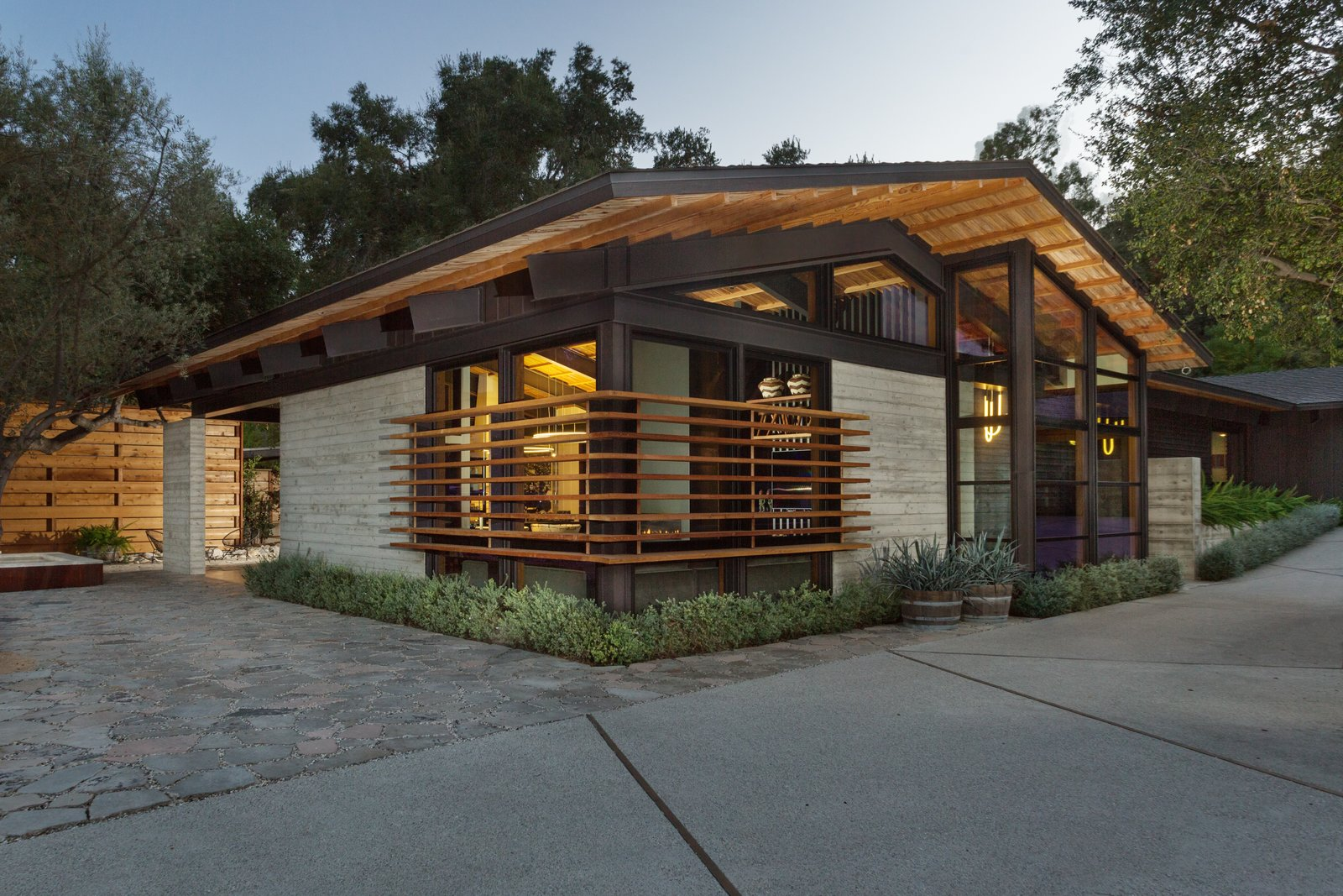 Exterior, Concrete, Metal, Wood, Mid-Century, and House The main house channels a midcentury vibe.  Exterior Wood Metal Concrete Mid-Century Photos from A Private California Compound Hits the Market at $5M