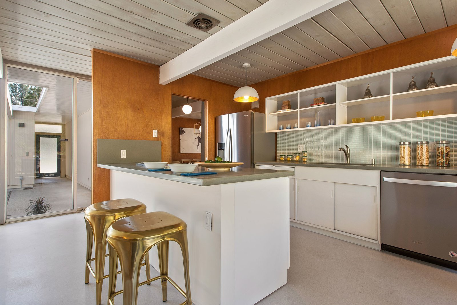 Kitchen, White, Drop In, Pendant, Dishwasher, Refrigerator, and Glass Tile The kitchen.  Best Kitchen Glass Tile Dishwasher Photos from An Elegant Eichler Hits the Market at $1.15M in Northern California