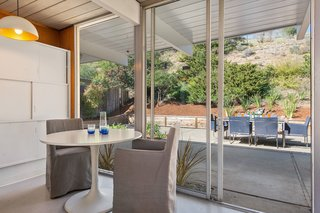 A small eating area overlooks the backyard.