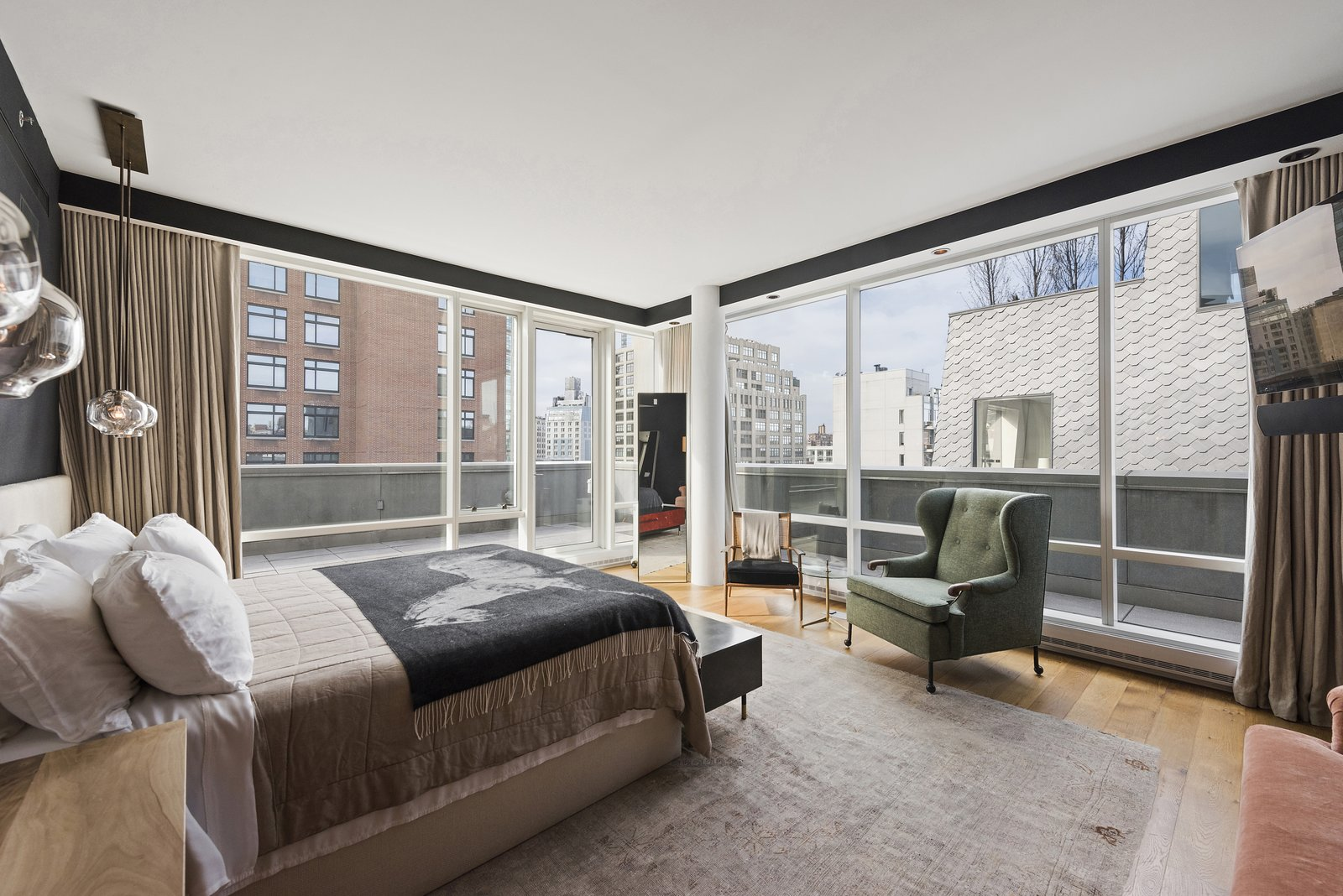 Bedroom, Medium Hardwood, Chair, Bed, Rug, Pendant, Recessed, Night Stands, and Bench The master bedroom features floor-to-ceiling windows and terrace access as well as a deluxe ensuite bathroom.  Best Bedroom Bench Pendant Chair Medium Hardwood Photos from Own Justin Timberlake's Posh Soho Penthouse For $8M