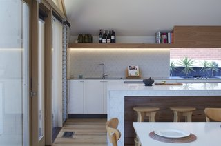 The extension created an open kitchen as well as additional interior space for dining and living.