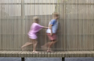 A fence at the rear ties into the contemporary design of the new extension.