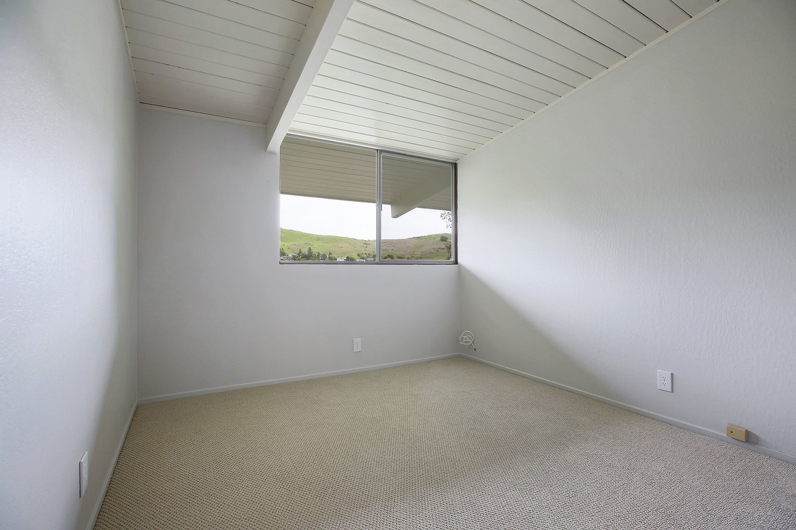 Bedroom and Carpet Floor One of the other bedrooms.  Photo 13 of 15 in This Rare Two-Story Eichler Has Just Been Listed For $1.35M