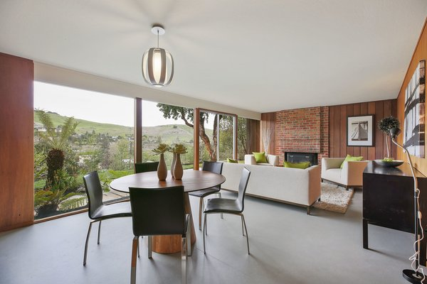 The spacious open living/dining room has an original wood burning fireplace.