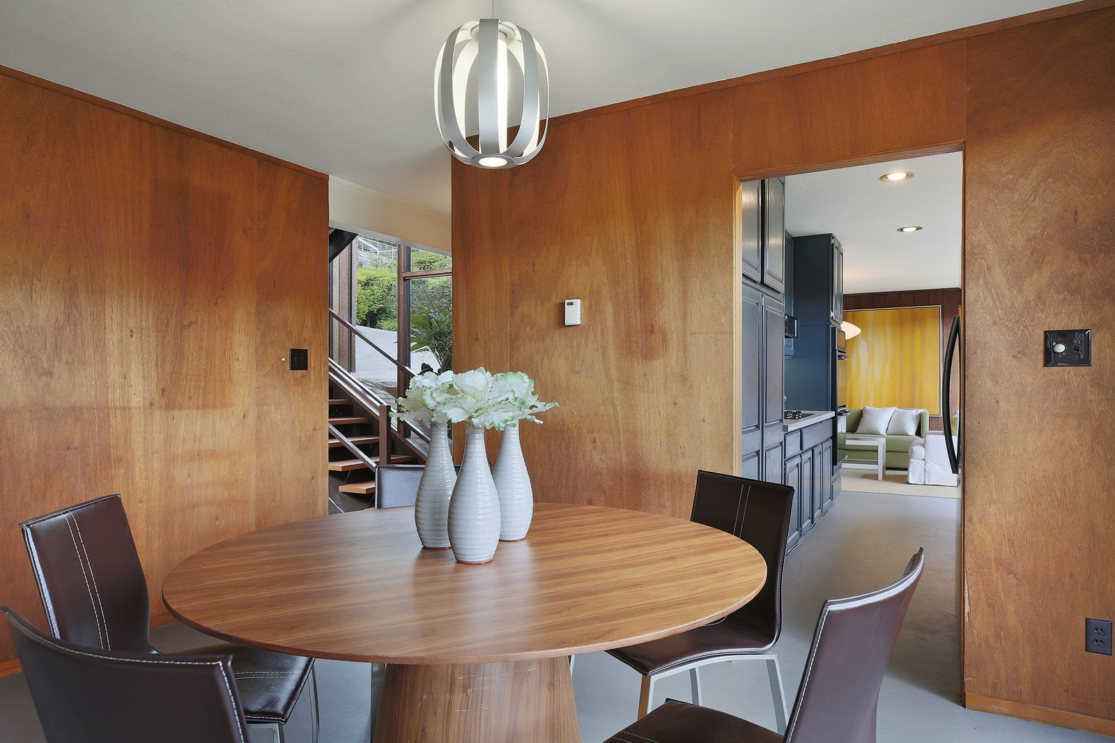 Dining Room, Pendant Lighting, Table, Chair, Recessed Lighting, and Concrete Floor The dining room area.  Photo 6 of 15 in This Rare Two-Story Eichler Has Just Been Listed For $1.35M