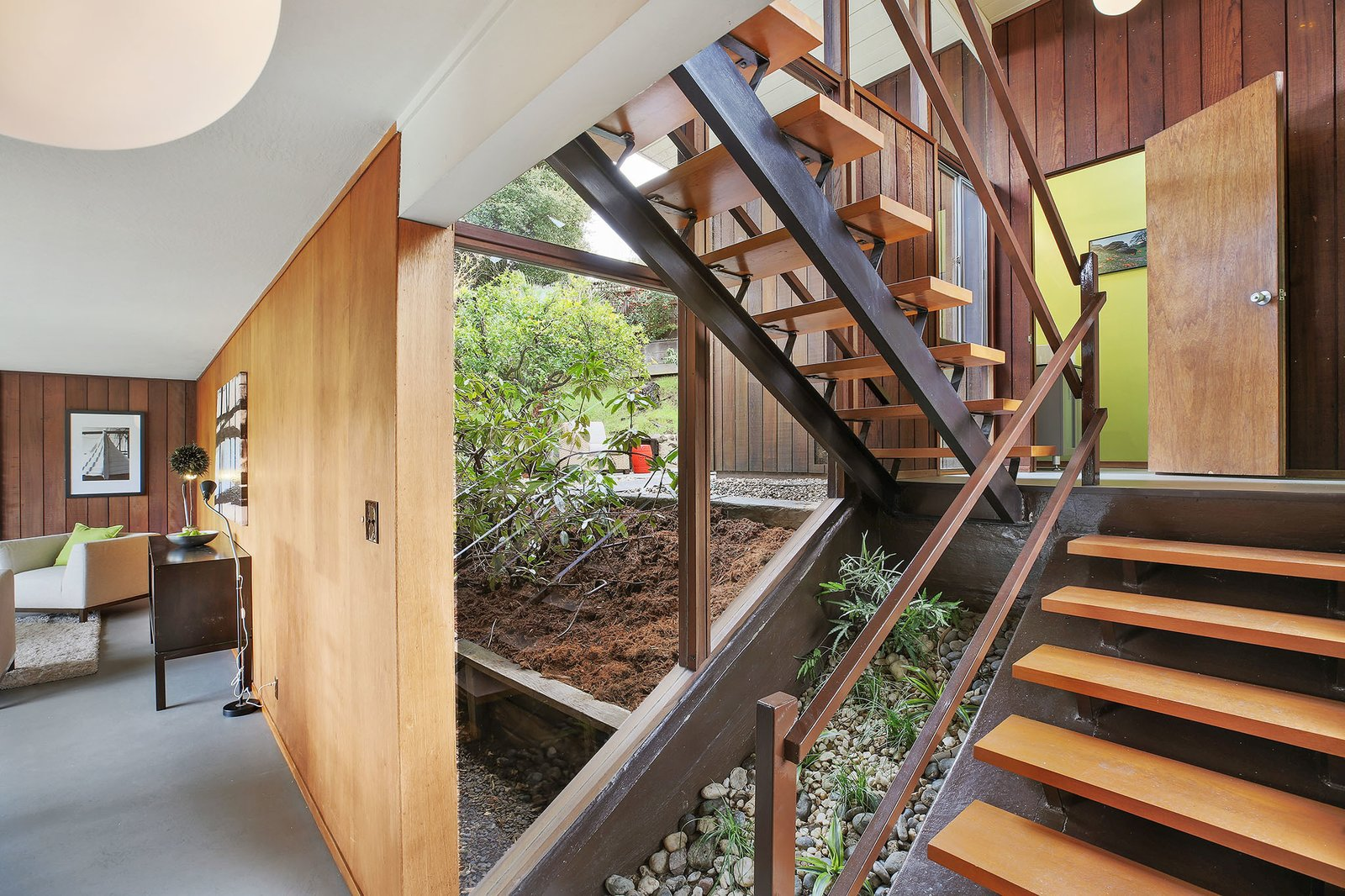 Staircase, Wood Tread, and Wood Railing All four bedrooms are located on the upper level.  Photo 11 of 15 in This Rare Two-Story Eichler Has Just Been Listed For $1.35M