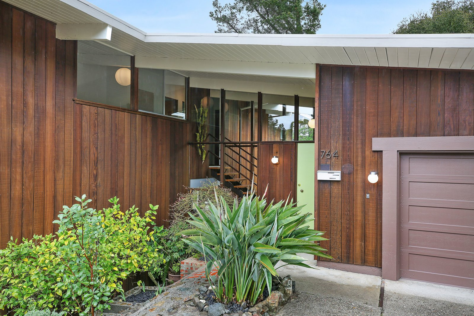 Exterior, Mid-Century Building Type, Flat RoofLine, Wood Siding Material, and House Building Type Two-story Eichlers are a rare breed.  Photo 2 of 15 in This Rare Two-Story Eichler Has Just Been Listed For $1.35M